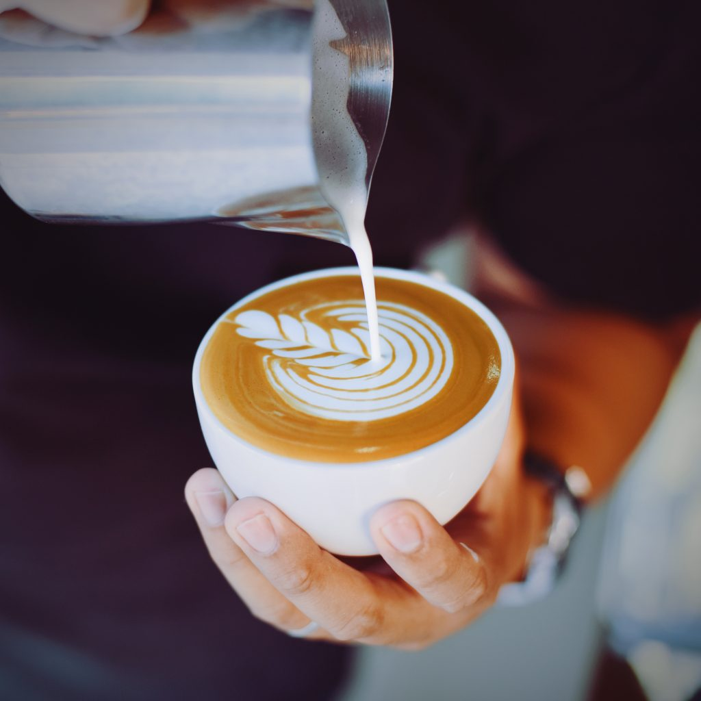 person who is making a latte